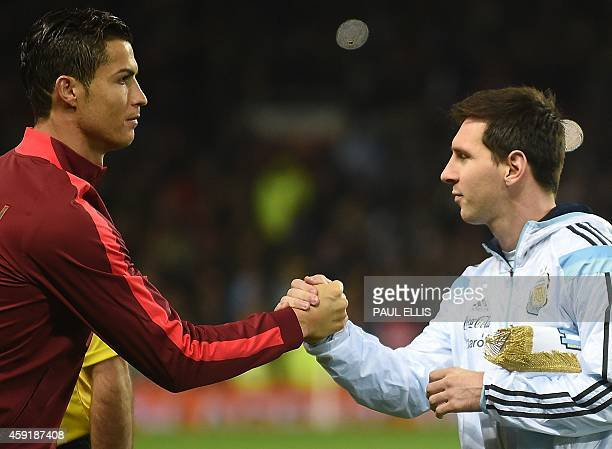 Argentina striker Lionel Messi shakes hands with Portugal's striker Cristiano Ronaldo ahead of kick off of the international friendly football match...