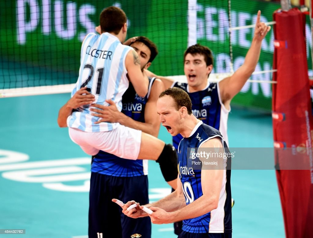Argentina team celebrate after winning a point during the FIVB World Championships match between Venezuela and Argentina on August 31, 2014 in Wroclaw, Poland.