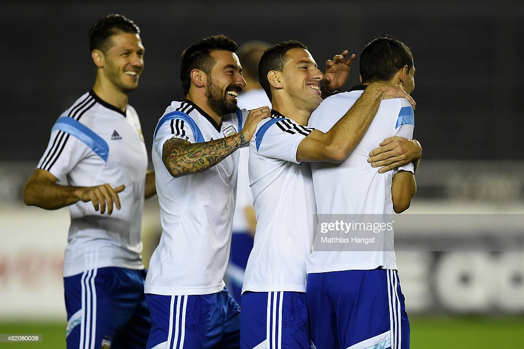 Argentina teammates Martin Demichelis, Gonzalo Higuain and Maxi Rodriguez share a joke with Angel di Maria during the Argentina training session, ahead of the 2014 FIFA World Cup Final, at Estadio Sao Januario on July 12, 2014 in Rio de Janeiro, Brazil.