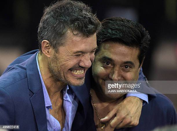 Argentina TV host San Lorenzo vicepresident and presidential candidate for the AFA Marcelo Tinelli hugs Boca Juniors' President Daniel Angelici...