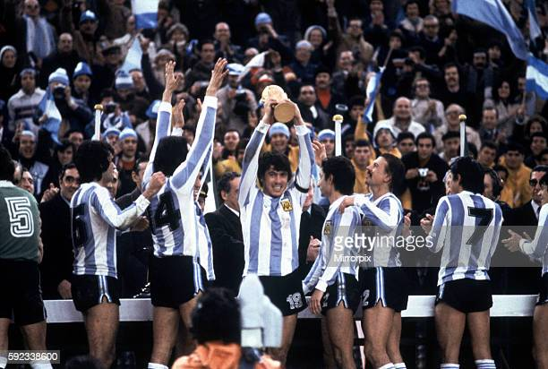Argentina won 31 aet Mario Kempes scoring twice Pictured Argentina with the trophy Daniel Passarella Captain lifts the trophy also pictured standing...