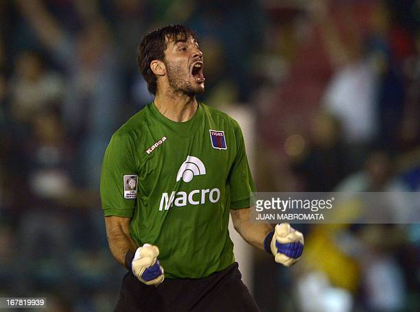 Argentinaian Tigre's goalkeeper Javier Garcia celebrates the team's second goal scored by teammate midfielder Matias Perez against Paraguay's Olimpia...
