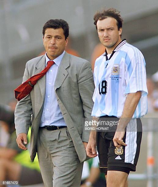 Argentinan coach Daniel Alberto Passarella and forward Abel Balbo look dejected 04 July after their 1998 Soccer World Cup quarterfinal match against...