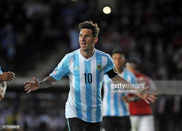 Argentinan football team player Lionel Messi celebrates after scoring against Paraguay in the Copa America football match in La Serena Chile on June...