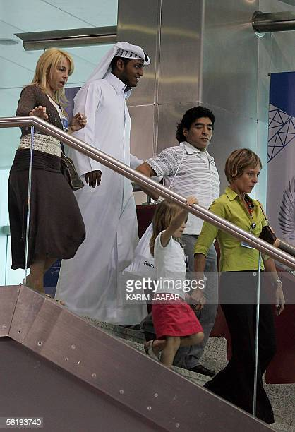 Argentina's 1986 World Cup winning hero Diego Maradona his wife and daughter arrive at a hotel in Doha 17 November 2005 Football legends Pele and...