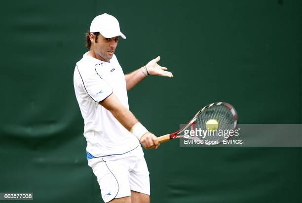 Argentina's Agustin Calleri in action against Spain's Guillermo GarciaLopez during the Wimbledon Championships 2009 at the All England Tennis Club