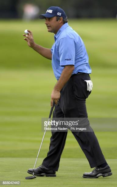 Argentina's Angel Cabrera birdies the 18th green to join Justin Rose as the clubhouse leader on 8 under par during the Second Round of the BMW...