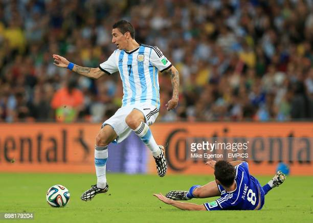 Argentina's Angel di Maria battles for the ball with BosniaHerzegovina's Miralem Pjanic