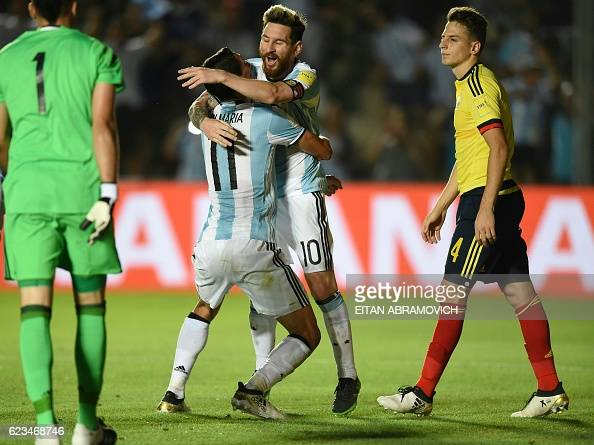 TOPSHOT Argentina's Angel Di Maria celebrates with Argentina's Lionel Messi after scoring against Colombia during their 2018 FIFA World Cup qualifier...