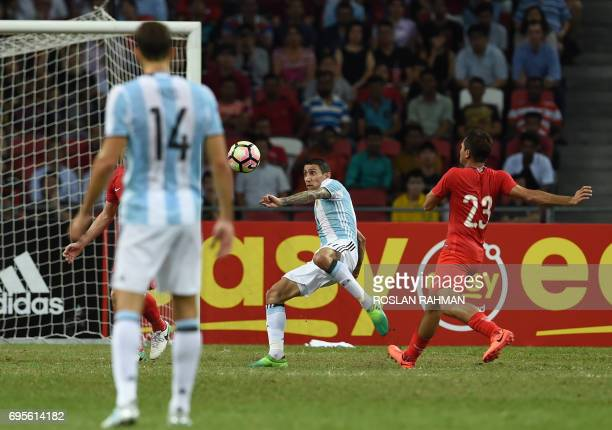 Argentina's Angel Di Maria shoots towards goal during the international friendly football match between Singapore and Argentina at the national...