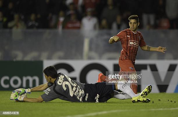 Argentina's Arsenal goalkeeper Esteban Andrada catches the ball next to Argentina's Independiente forward Martin Benitez during their Copa...
