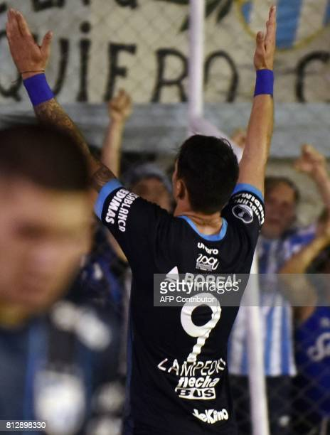 Argentina's Atletico Tucuman Fernando Zampedri celebrates with supporters after scoring against Bolivia's Oriente Petrolero during their Sudamericana...