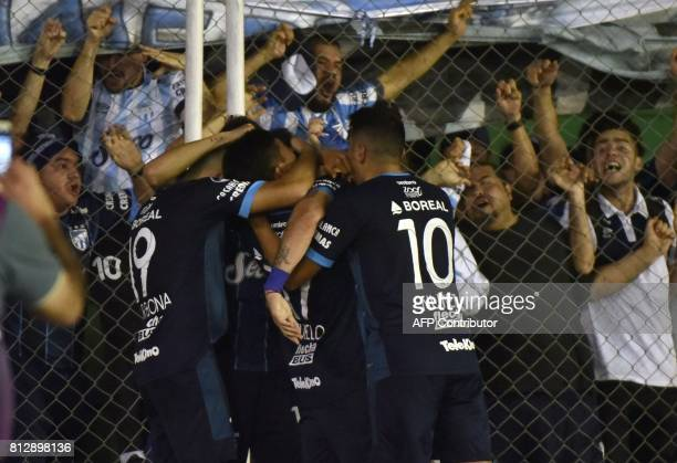 Argentina's Atletico Tucuman footballers celebrate with supporters after scoring against Bolivia's Oriente Petrolero during their Sudamericana Cup...