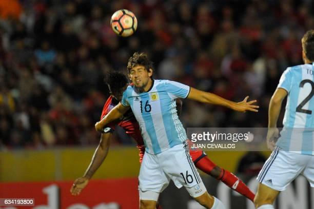 Argentina's Atletico Tucuman player Enrique Meza vies for the ball with Ecuador's El Nacional Bryan De Jesus during their 2017 Copa Libertadores...