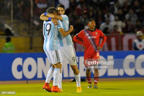 Argentina's Atletico Tucuman player Fernando Zampedri celebrates with a teammate his goal against El Nacional of Ecuador during their 2017 Copa...