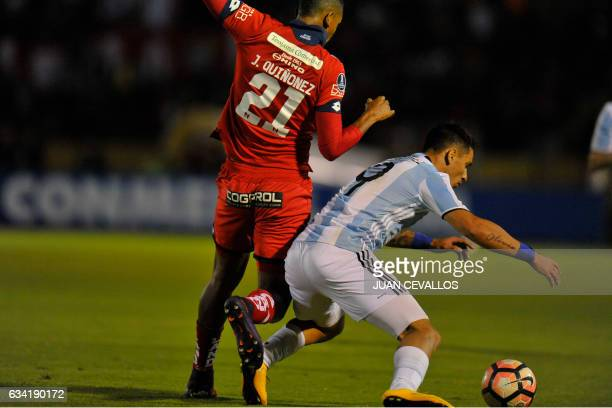 Argentina`s Atletico Tucuman player Fernando Zampedri vies for the ball with Ecuador's El Nacional Javier Quinonez during their 2017 Copa...