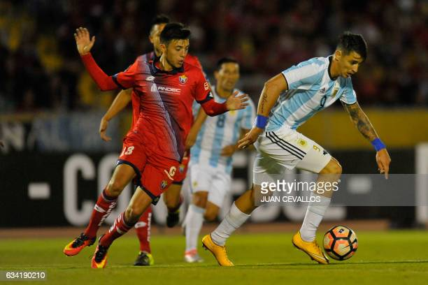 Argentina`s Atletico Tucuman player Fernando Zampedri vies for the ball with Ecuador's El Nacional Roberto Daniel Garces during their 2017 Copa...