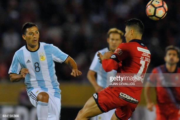 Argentina's Atletico Tucuman player Guillermo Acosta vies for the ball with Ecuador's Nacional Fabert Balda during their 2017 Copa Libertadores...