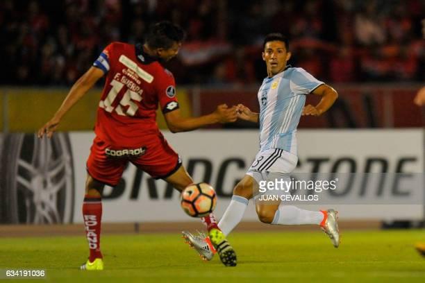 Argentina`s Atletico Tucuman player Guillermo Gastón Acosta vies for the ball with Ecuador's El Nacional Franklin Guerra during their 2017 Copa...
