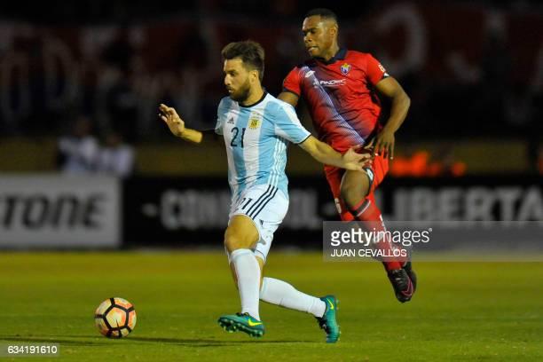 Argentina`s Atletico Tucuman player Ignacio Canuto vies for the ball with Ecuador's El Nacional Felix Borja during their 2017 Copa Libertadores...