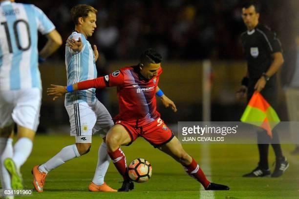 Argentina`s Atletico Tucuman player Nery Leyes vies for the ball with Ecuador's El Nacional Fabert Manuel Balda during their 2017 Copa Libertadores...