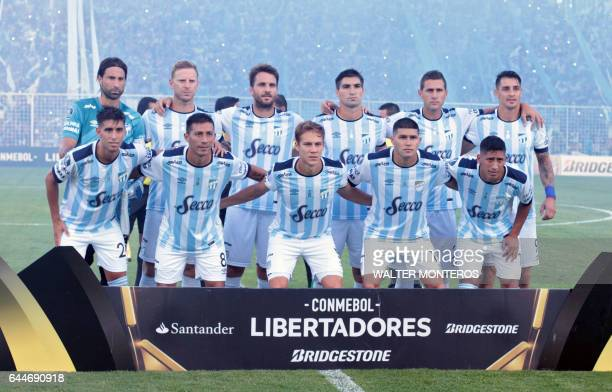 Argentina's Atletico Tucuman players pose for photos before their Copa Libertadores football match with Colombia's Junior at the Jose Fierro stadium...