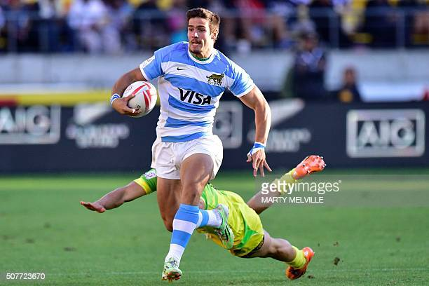 Argentina's Axel Muller is tackled by Australia's Greg Jeloudev during the plate final on the second day of the Wellington Sevens rugby Union...