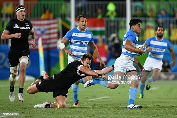 Argentina's Axel Muller is tackled by New Zealand's Tim Mikkelson in the mens rugby sevens match between New Zealand and Argentina during the Rio...