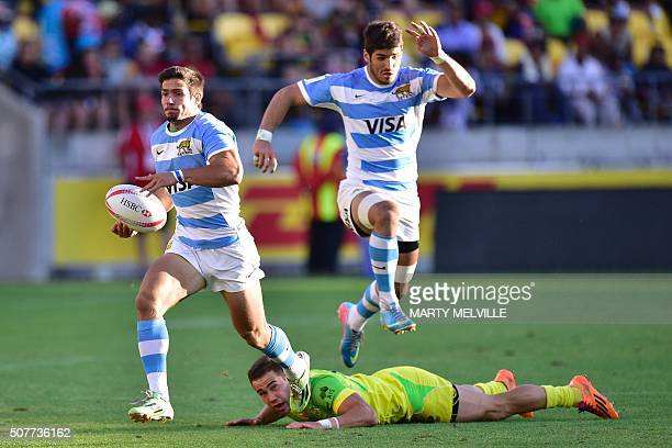Argentina's Axel Muller runs out of a tackle by Australia's Greg Jeloudev as German Schulz jumps during the plate final on the second day of the...