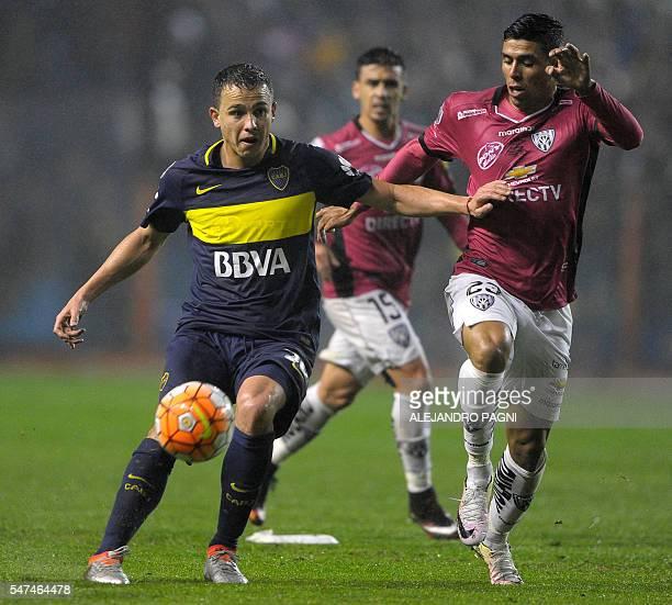 Argentina's Boca Juniors defender Leonardo Jara vies for the ball with Ecuador's Independiente del Valle midfielder Emiliano Tellechea during the...