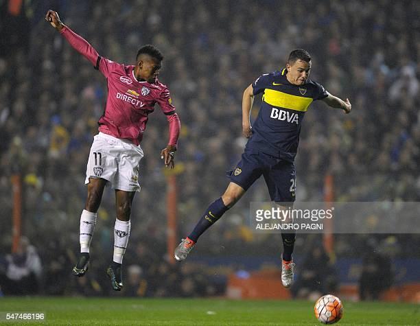 Argentina's Boca Juniors defender Leonardo Jara vies for the ball with Ecuador's Independiente del Valle midfielder Bryan Cabezas during the Copa...