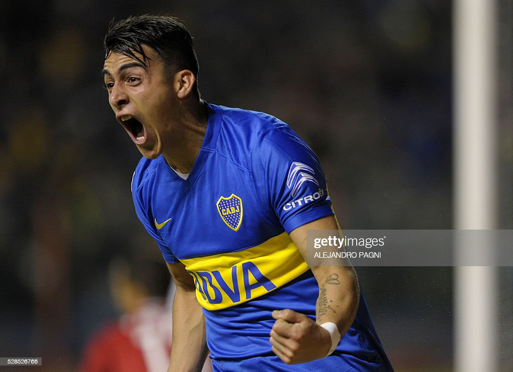 Argentina's Boca Juniors forward Cristian Pavon celebrates after scoring the team's second goal against Paraguay's Cerro Porteno during their Copa Libertadores 2016 round before the quarterfinals second leg football match at La Bombonera stadium in Buenos Aires, Argentina, on May 5, 2016. / AFP / ALEJANDRO
