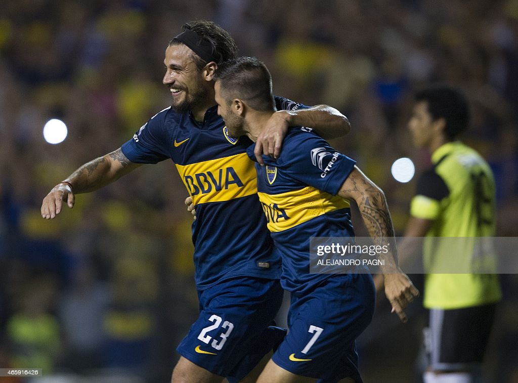Argentina's Boca Juniors' forward Daniel Osvaldo (L) celebrates with forward Juan Manuel Martinez (R) after scoring the team's fourth goal against Venezuela's Zamora during their Copa Libertadores 2015 group 5 football match at La Bombonera stadium in Buenos Aires, Argentina, on March 11, 2015.