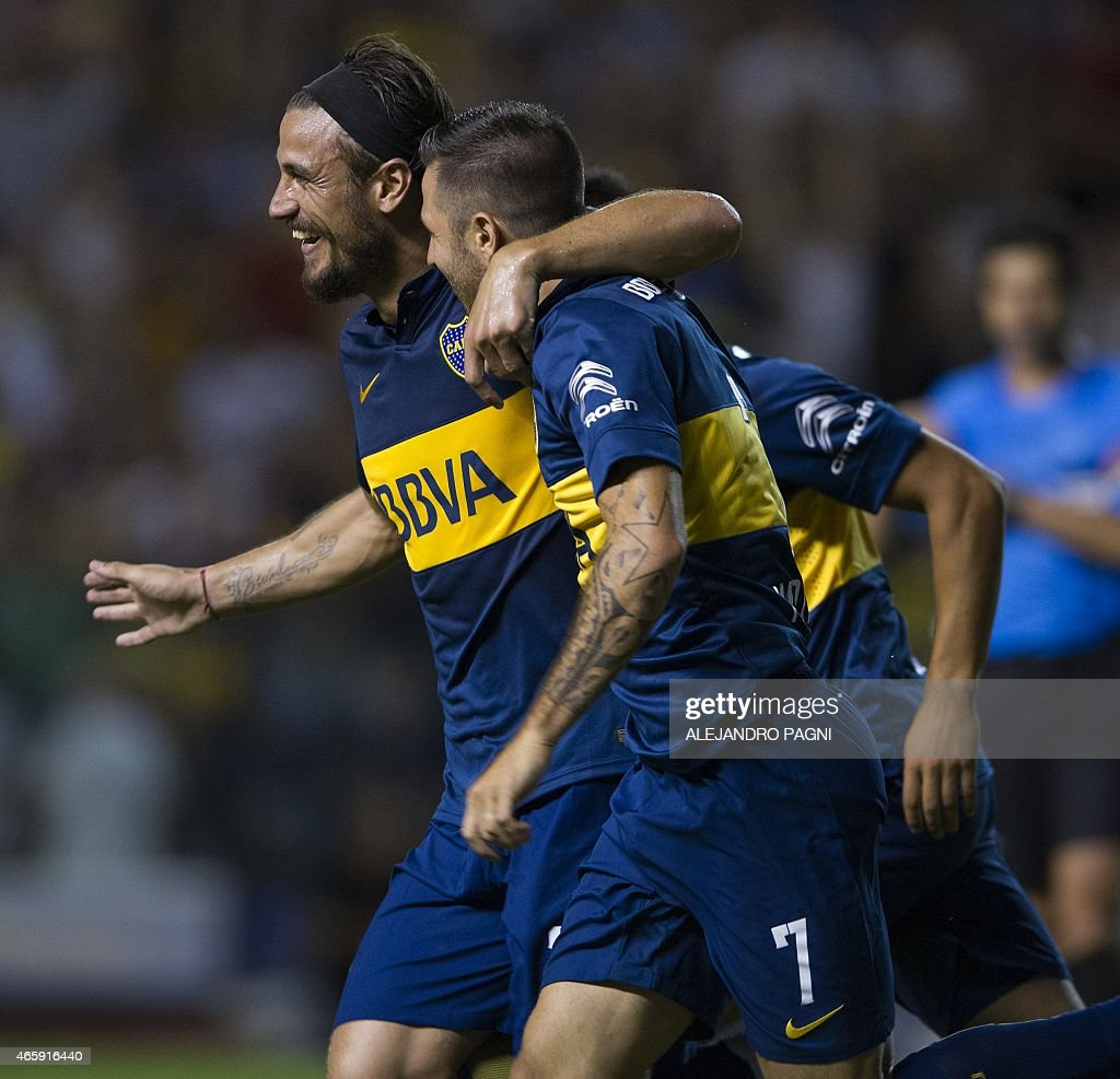 Argentina's Boca Juniors' forward Daniel Osvaldo (L) celebrates with forward Juan Manuel Martinez (C) after scoring the team's fourth goal against Venezuela's Zamora during their Copa Libertadores 2015 group 5 football match at La Bombonera stadium in Buenos Aires, Argentina, on March 11, 2015.