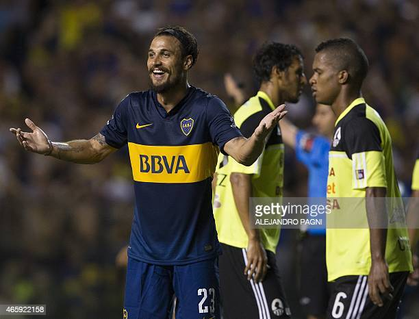 Argentina's Boca Juniors' forward Daniel Osvaldo gestures after missing a chance of goal against Venezuela's Zamora during their Copa Libertadores...