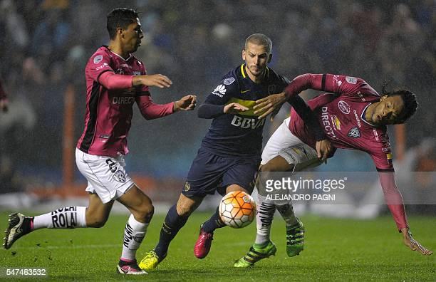 Argentina's Boca Juniors forward Dario Benedetto vies for the ball with Ecuador's Independiente del Valle defenders Luis Leon and Arturo Mina Meza...