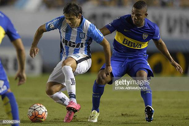 Argentina's Boca Juniors Frank Fabra vies for the ball with Argentina's Racing Club midfielder Oscar Romero midfielder during the Copa Libertadores...