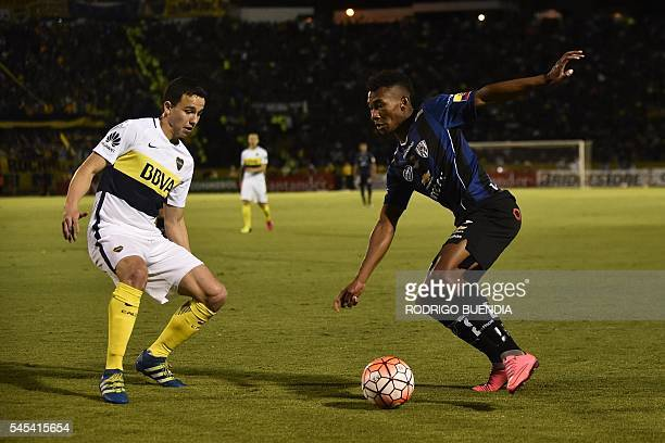 Argentina's Boca Juniors Leonardo Jara vies for the ball with Ecuador's Independiente del Valle Bryan Cabezas during their 2016 Copa Libertadores...