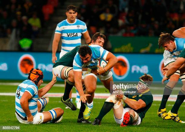 Argentina's captain and hooker Agustin Creevy is tackled during the International Rugby Championship Test match between Argentina and South Africa at...