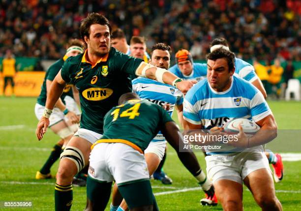 Argentina's captain and hooker Agustin Creevy runs with the ball during the International Rugby Championship Test match between Argentina and South...