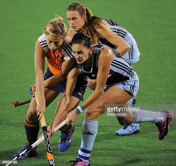 Argentina's captain Luciana Aymar vies with Wieke Dijkstra of the Netherlands during their Women's Champions Trophy hockey match in Sydney on July 16...