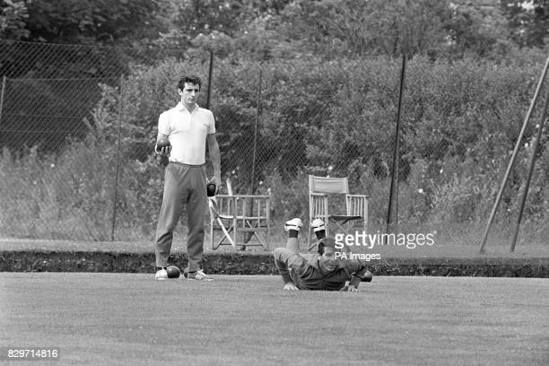 Argentina's Carmelo Simeone looks on as teammate Alfredo Rojas launches his wood at the jack during a relaxing game of bowls