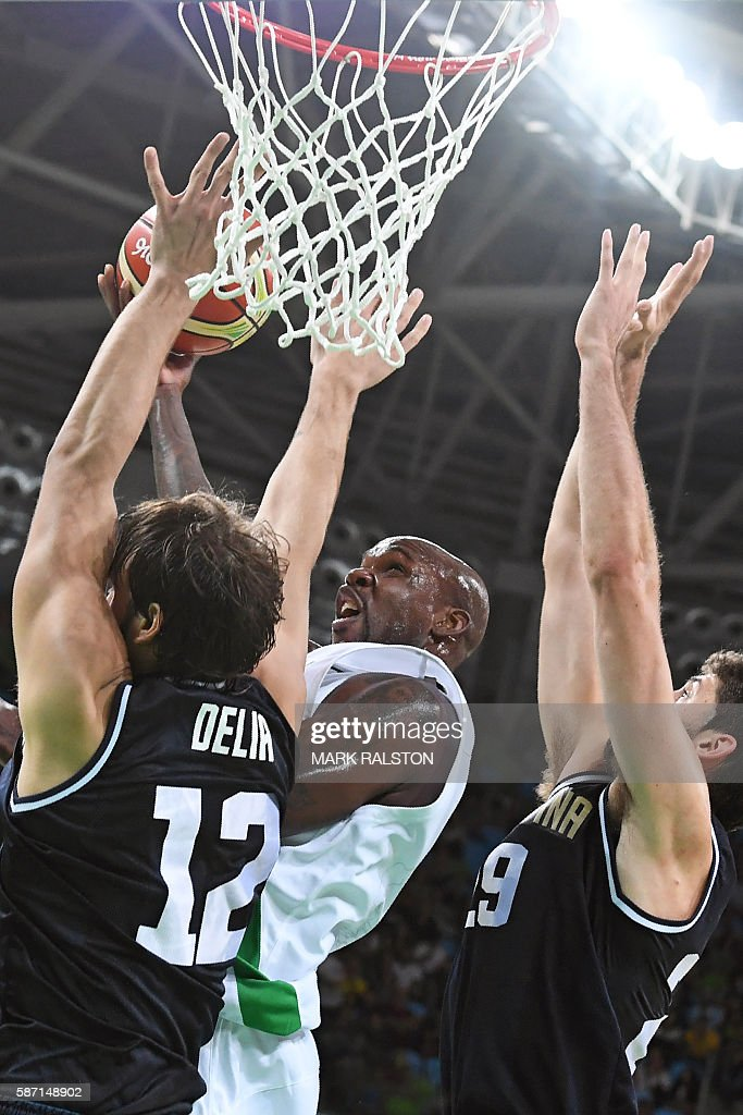 Argentina's centre Marcos Delia Nigeria's small forward AlFarouq Aminu and Argentina's shooting guard Patricio Garino go for a rebound during a Men's...