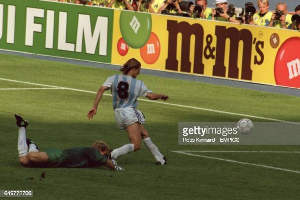 Argentina's Claudio Caniggia goes round Brazil's goalkeeper Taffarel to score the winning goal