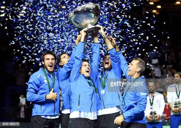 Argentina's coach Daniel Orsanic Juan martin del Potro Guido Pella Federico Delbonis and Leonardo Mayer celebrate with the trophy after winning the...