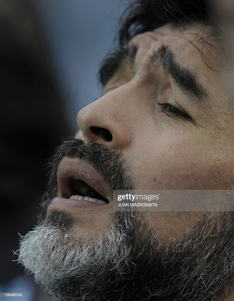 Argentina's coach Diego Maradona sings national anthem before start the friendly football match against Canada at the Monumental stadium in Buenos Aires, on May 24, 2010. Argentina won 5-0 in their last match before flyes to Johannesbourg on May 28, to take part in the 2010 FIFA World Cup South Africa. AFP PHOTO / Juan Mabromata