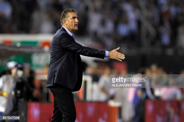 Argentina's coach Edgardo Bauza gestures during their 2018 FIFA World Cup qualifier football match against Chile at the Monumental stadium in Buenos...