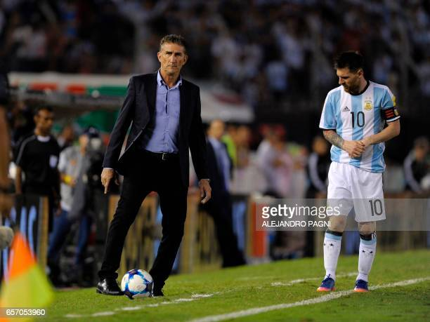 Argentina's coach Edgardo Bauza gestures next to Argentina's forward Lionel Messi during their 2018 FIFA World Cup qualifier football match against...