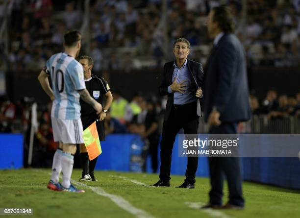 Argentina's coach Edgardo Bauza gestures next to Chile's coach Juan Antonio Pizzi during their 2018 FIFA World Cup qualifier football match at the...