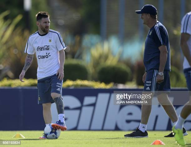 Argentina's coach Edgardo Bauza talks to forward Lionel Messi during a training session in Ezeiza Buenos Aires on March 21 2017 ahead of their World...